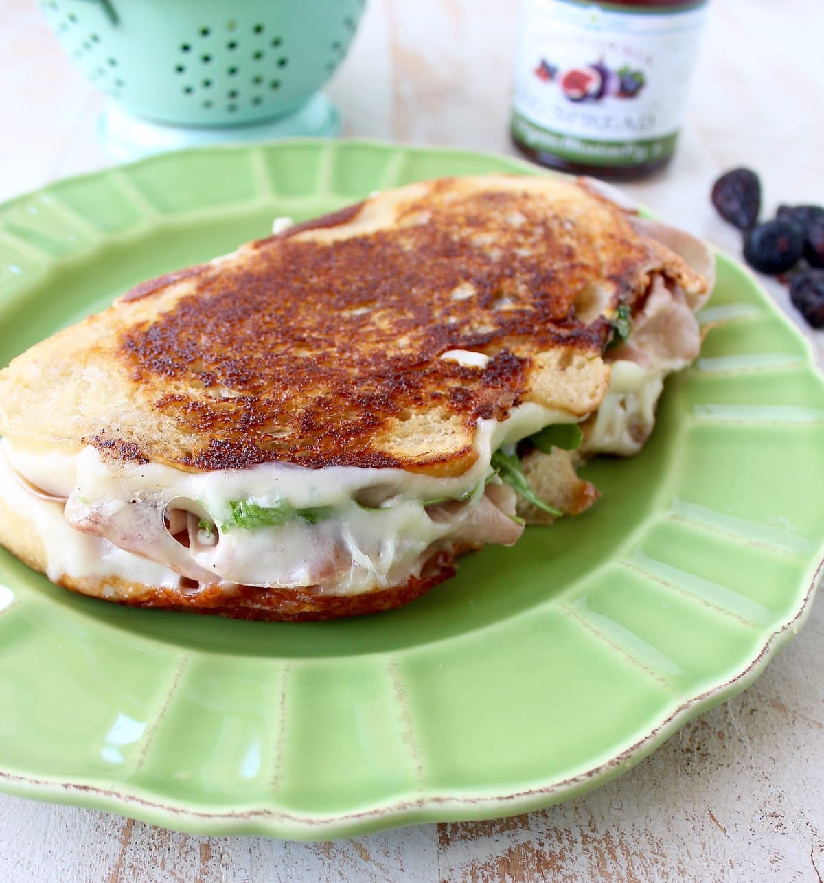 This Fig Grilled Cheese Sandwich recipe is filled with prosciutto, provolone, blue cheese, arugula & fig jam for a flavorful, delicious & filling sandwich!