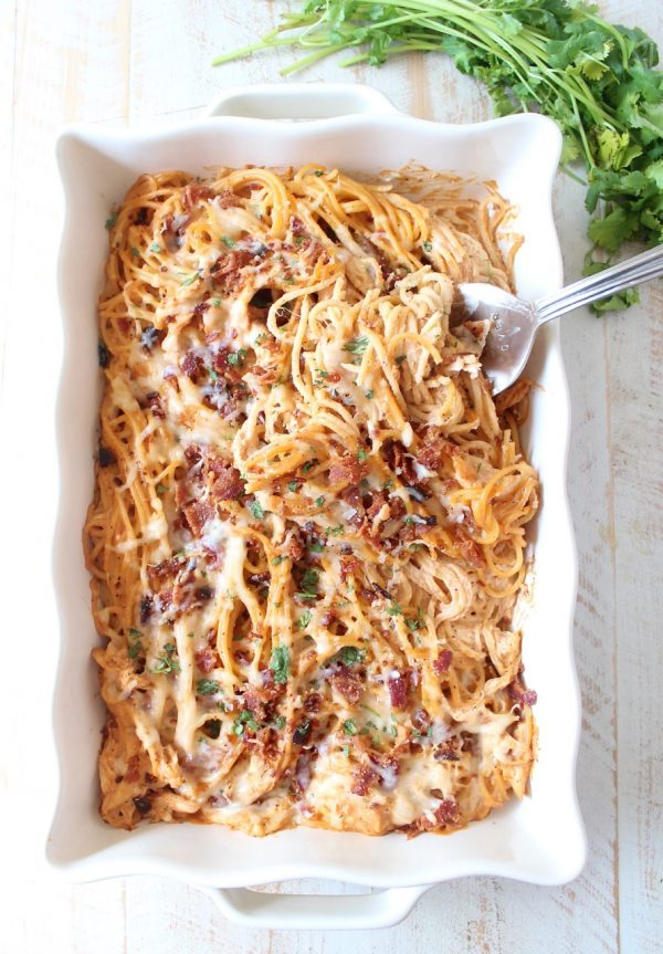 This creamy, dreamy Baked Spaghetti recipe is tossed in a cheesy, bbq sauce with shredded chicken & crispy bacon for a delicious meal made in under an hour!