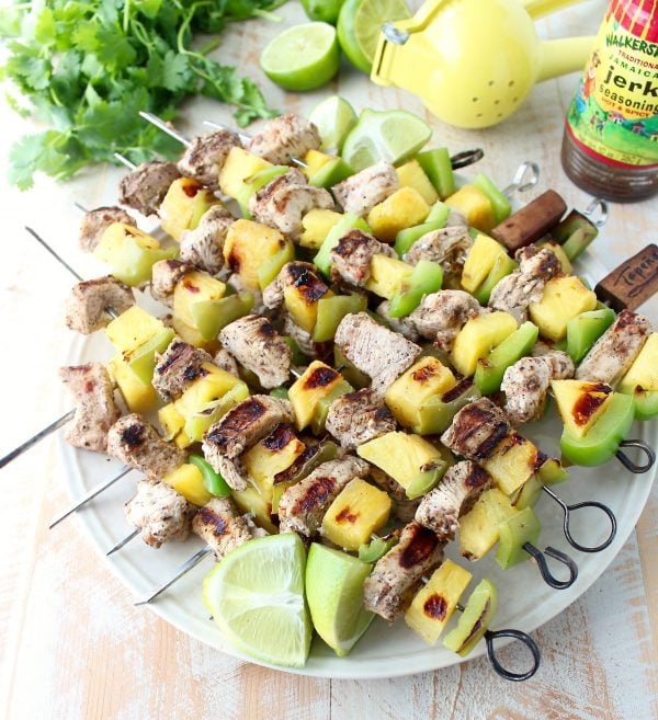 Jerk chicken kabobs with pineapple and bell peppers, the perfect 5-ingredient, gluten free recipe to toss on the grill and serve with honey lime sauce!