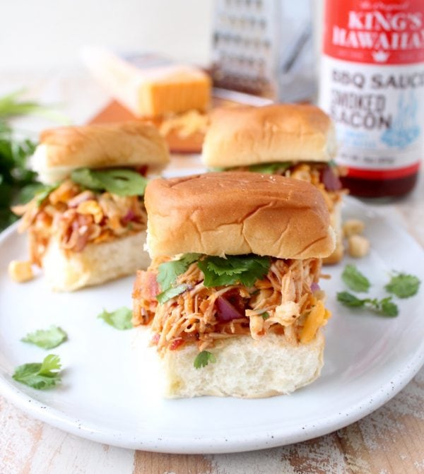 These scrumptious BBQ Chicken Salad Sliders are made with BBQ chicken tossed with cheddar cheese, bacon, corn & onions, served on sweet Hawaiian rolls!