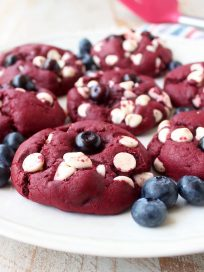 Red Velvet Cookies are filled with white chocolate chips and blueberries in this colorful and patriotic dessert recipe, perfect for summer and 4th of July!