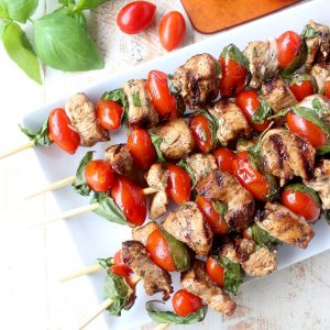 The easiest & most delicious Tomato Basil Chicken Skewers are made with marinated chicken, cherry tomatoes & fresh basil for a healthy, gluten free meal!