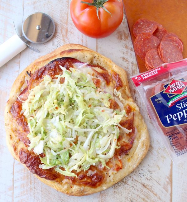 All of the ingredients in a traditional Italian Sub, like salami, pepperoni & provolone, top this delicious Italian Sub Pizza Recipe, easily made in under 30 minutes in the oven or on the grill!