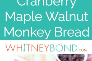 Maple syrup, dried cranberries and walnuts top this decadent monkey bread recipe that's perfect for fall brunches and holiday breakfasts!
