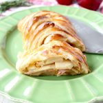 Warm caramelized apples & creamy brie cheese are wrapped up in a puff pastry for an easy & delicious apple strudel recipe, great for breakfast, an appetizer or dessert!