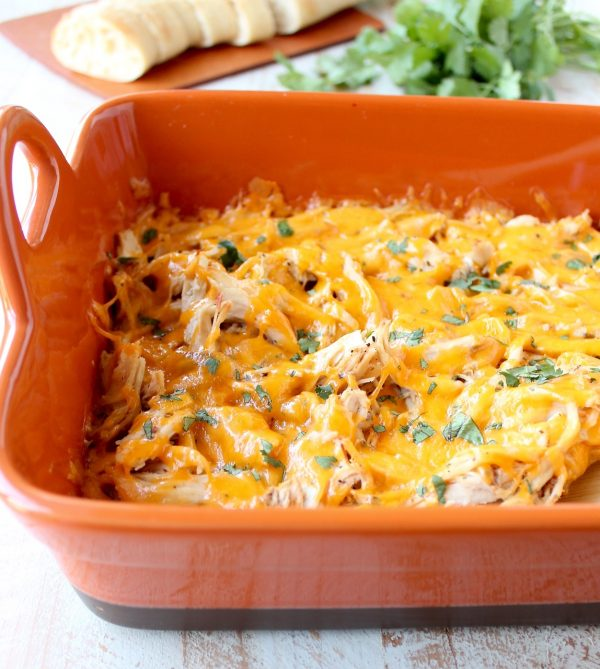 Shredded cajun turkey is placed on a layer of cajun ranch cream cheese and topped with cheddar cheese in this ultimate Cajun Turkey Cheese Dip recipe!