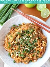 Overhead image of pad thai in bowl with chopsticks on the side