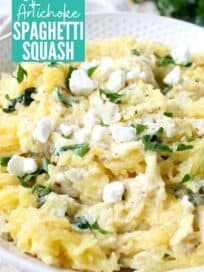 roasted spaghetti squash in bowl with spinach artichoke sauce