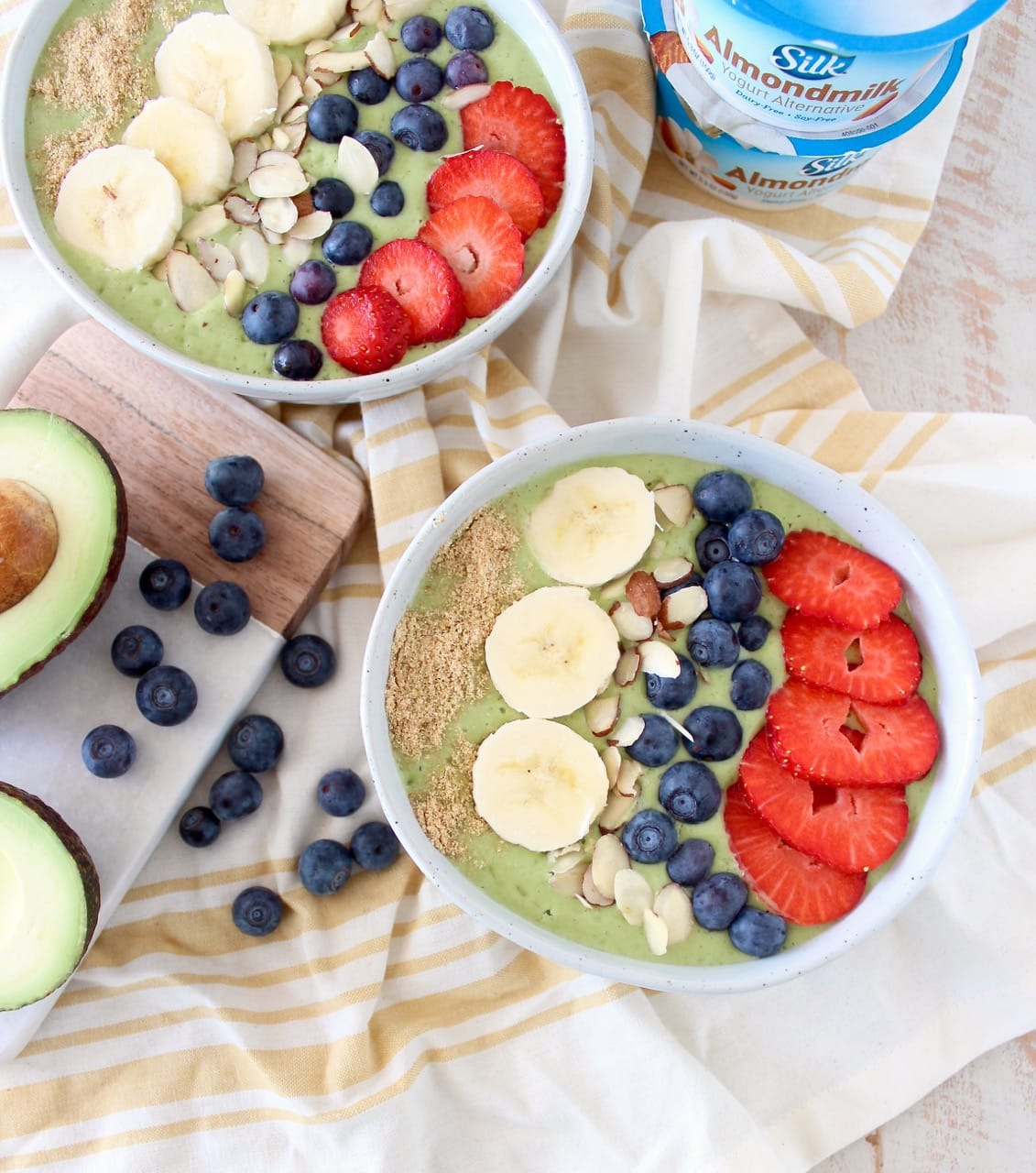 Fresh avocados, bananas and spinach are blended up with almond milk yogurt and coconut water in this delicious, vegan avocado smoothie bowl recipe!