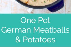 german meatballs and potatoes in creamy sauce in blue cast iron skillet