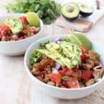 Taco seasoned ground turkey cooked with peppers, onions and tomatoes, tops this gluten free, dairy free, Whole30 taco salad recipe, made in just 20 minutes!