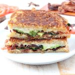 Crispy bacon, creamy avocado and juicy tomatoes are combined in this scrumptious gruyere and avocado grilled cheese sandwich recipe!