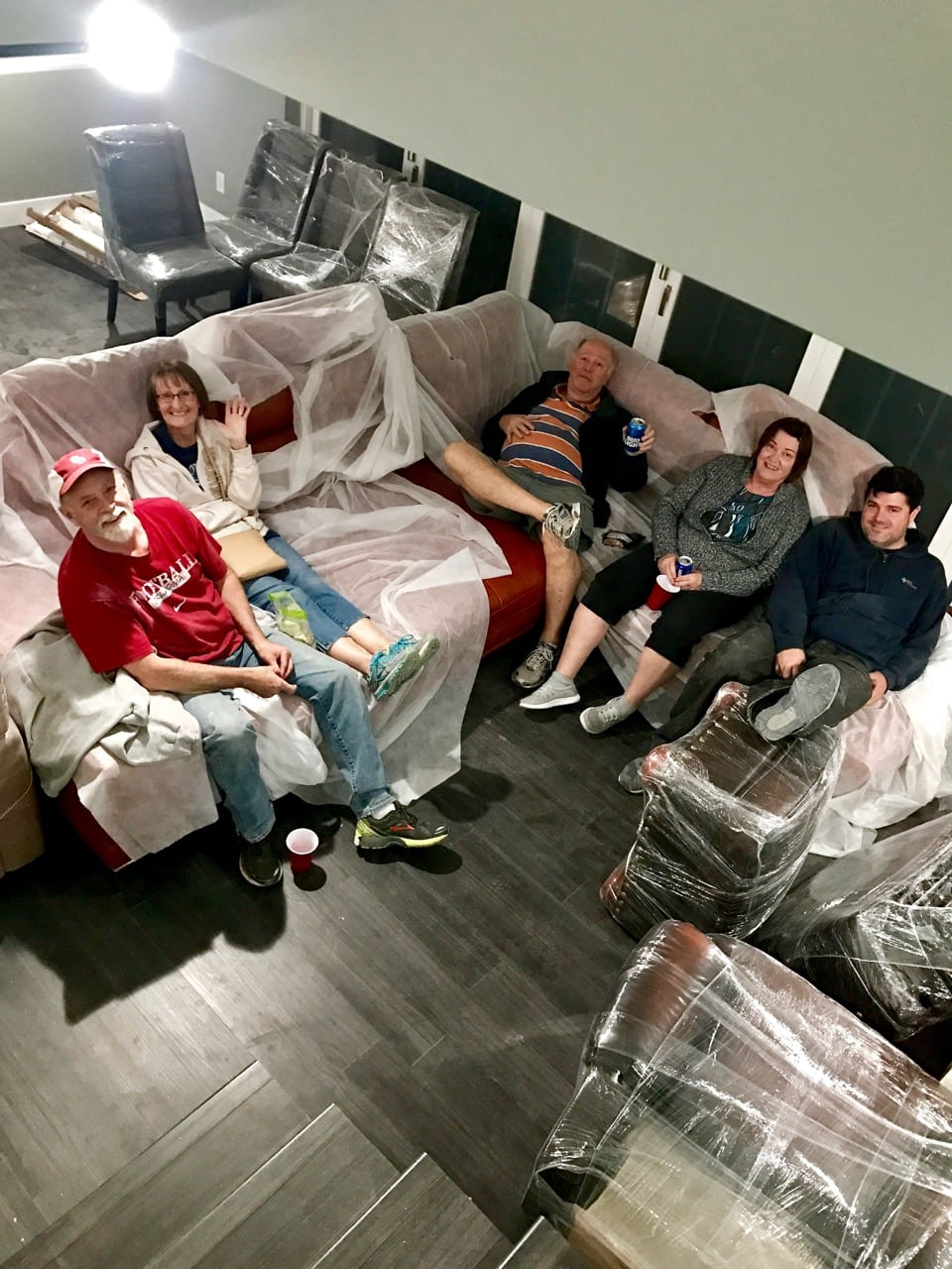 Family on couch after moving