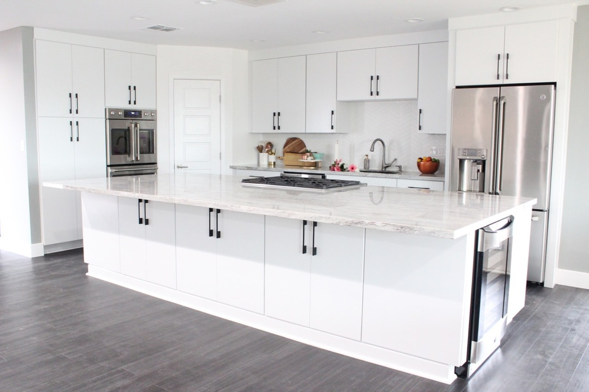 Kitchen Remodel with White Kitchen Cabinets are large 12 foot island with granite countertops