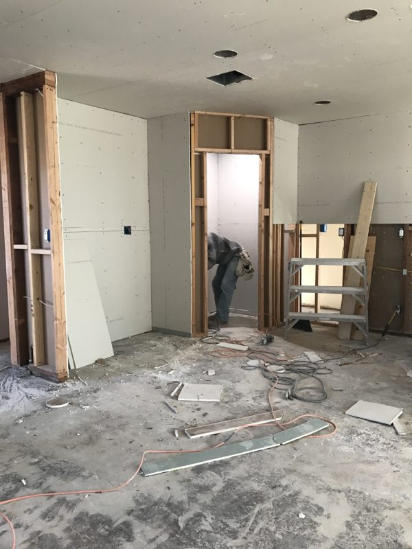 Drywall being hung in kitchen