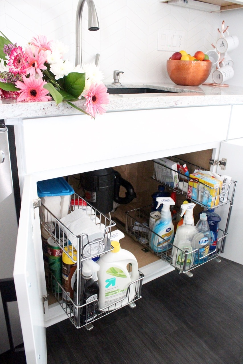 Under sink pull out wire racks for cleaning supplies