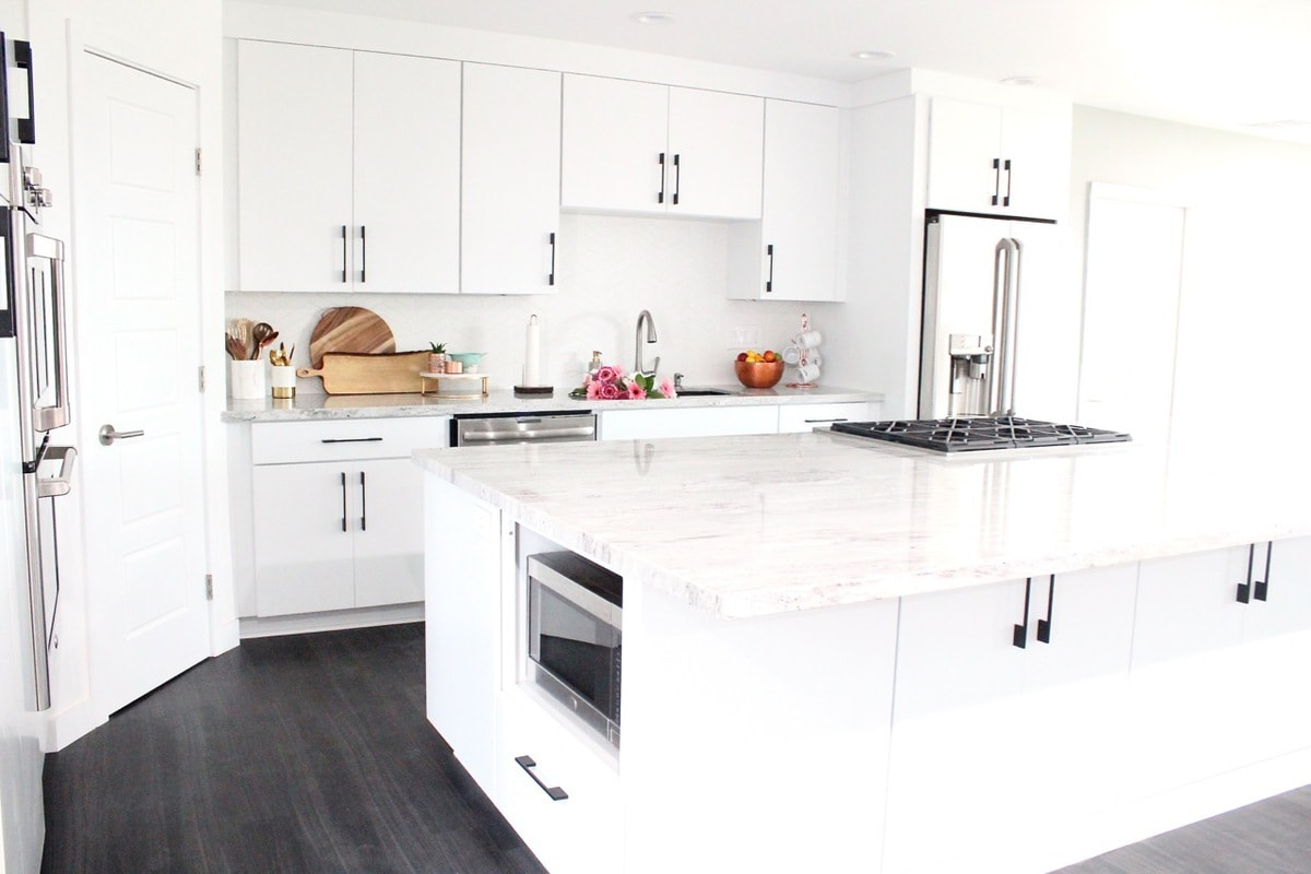 White Kitchen with New River White Granite Countertops and Large 12 foot island
