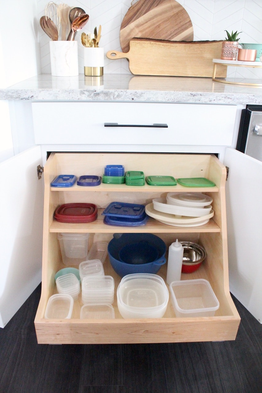 Cabinet with pull out shelves for organizing storage containers