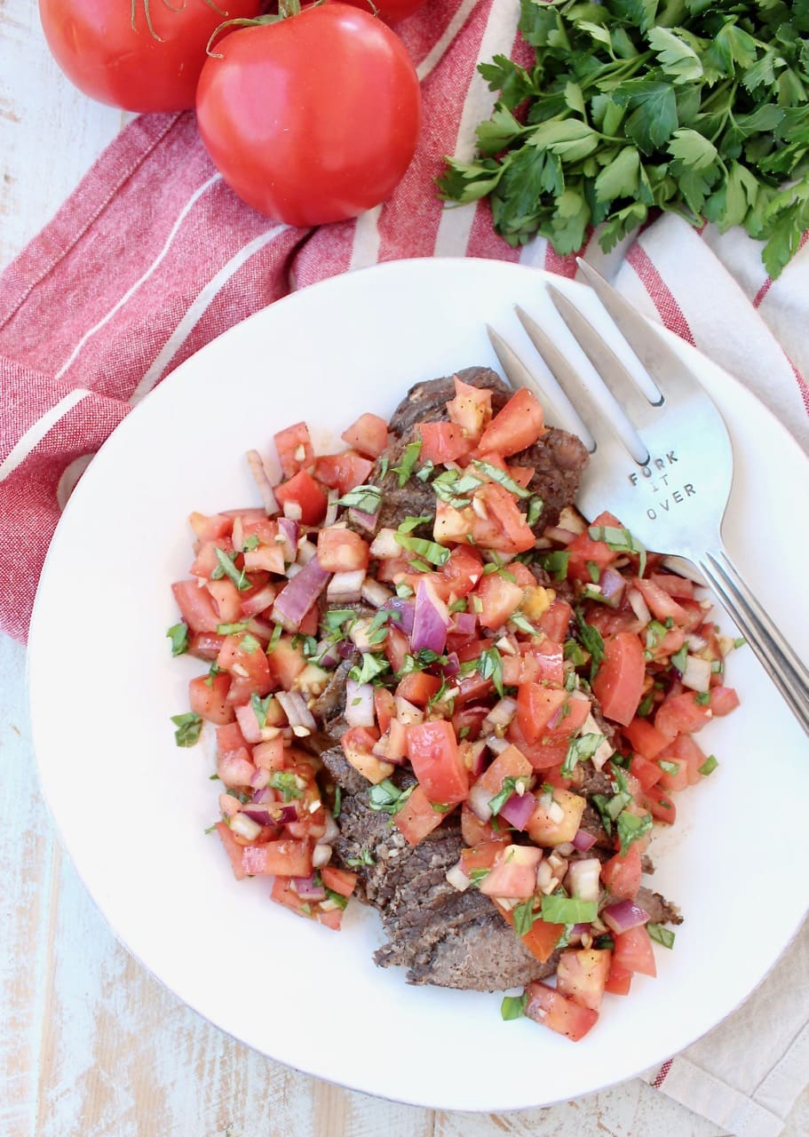 Instant Pot Beef sliced and topped with Tomato Basil Bruschetta
