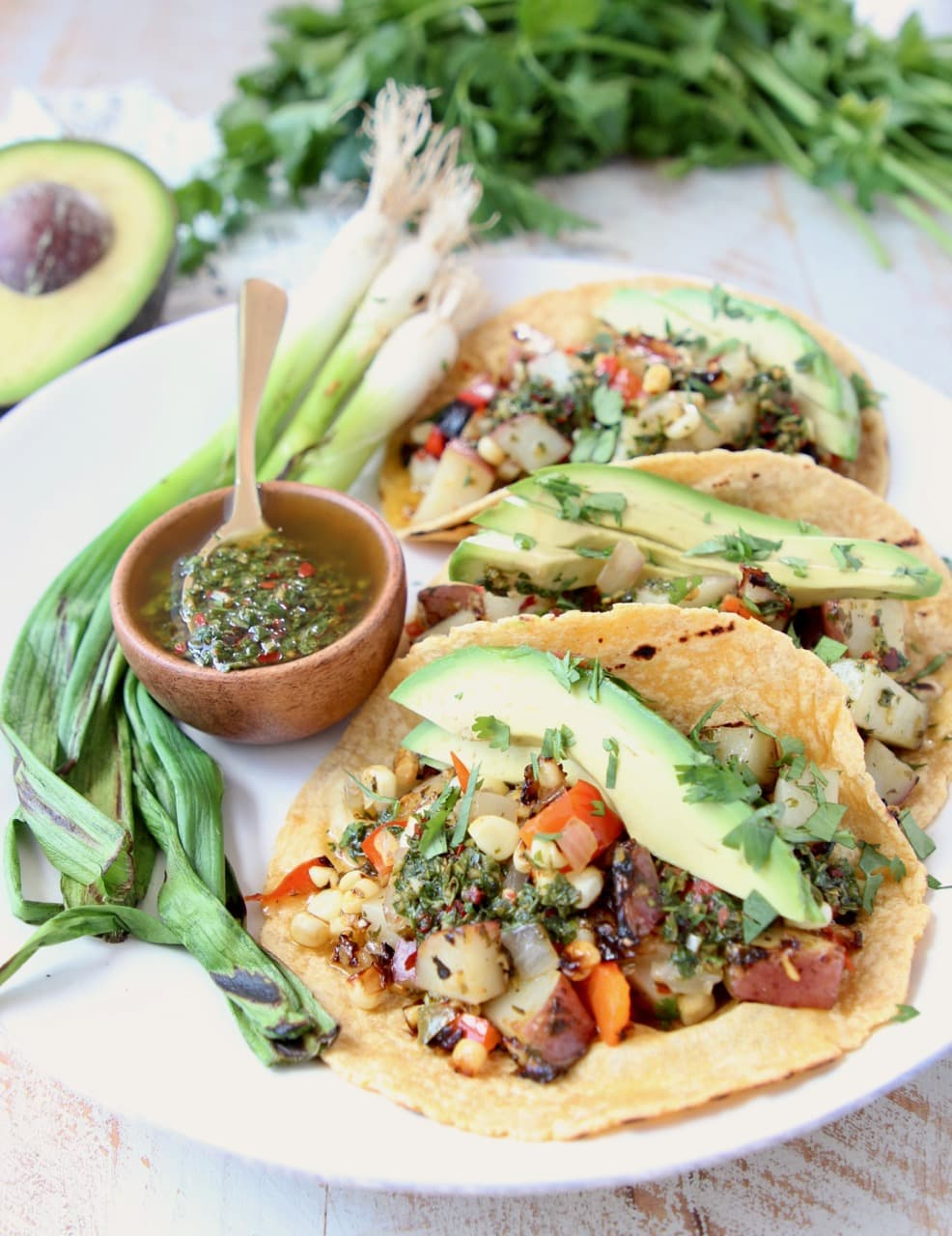 Grilled Vegan Tacos with Potatoes, Peppers, Avocado and Chimichurri Sauce