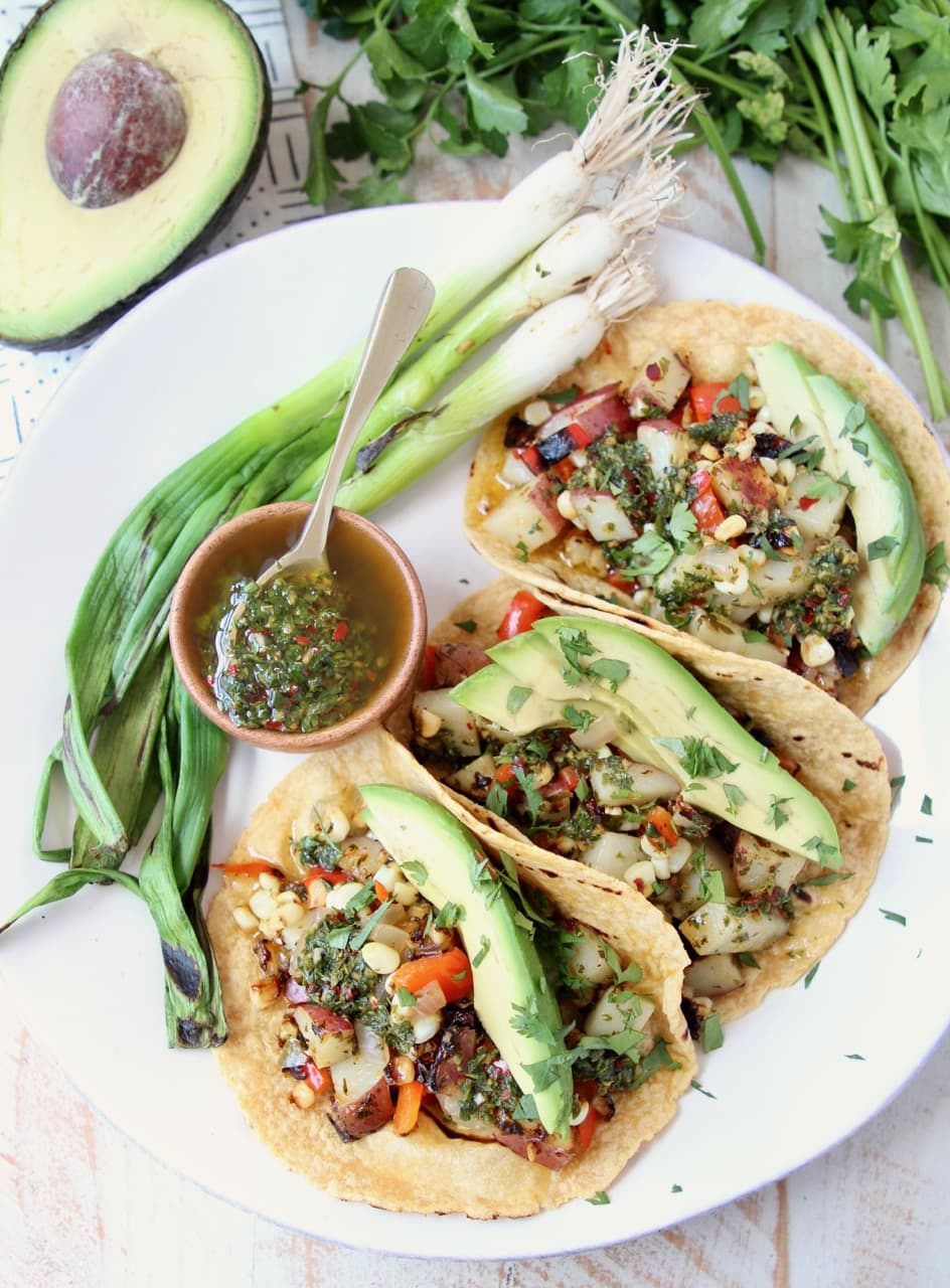 Vegan Tacos on Corn Tortillas with Grilled Vegetables, Grilled Green Onions, Avocado and Chimichurri Sauce