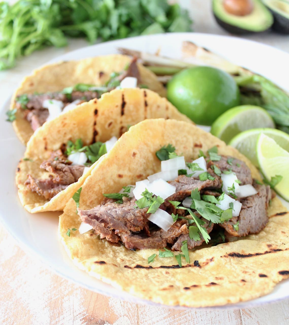 Carne Asada Tacos with Fresh Limes, Onions and Cilantro
