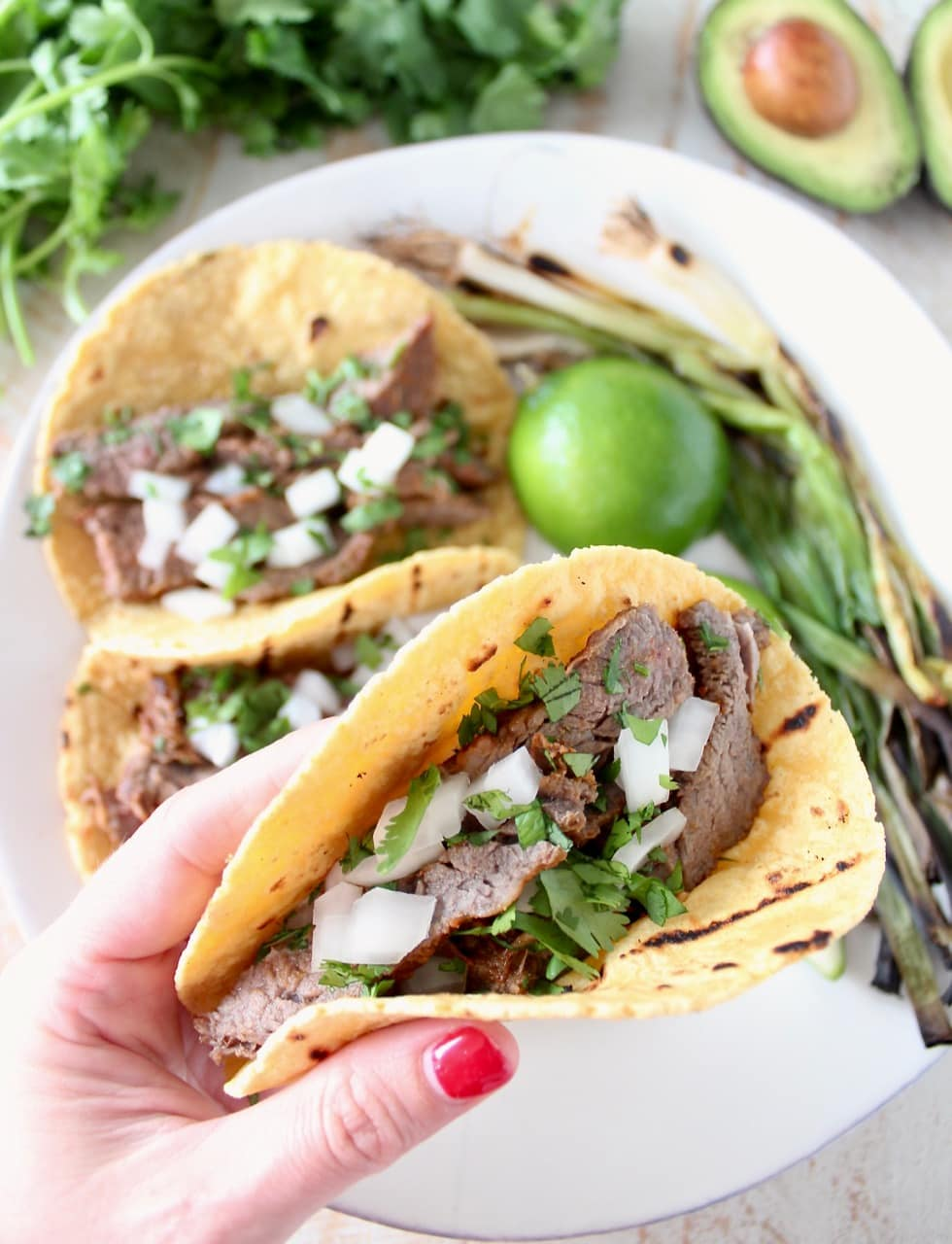 Carne Asada Tacos with Onions, Cilantro and Grilled Green Onions