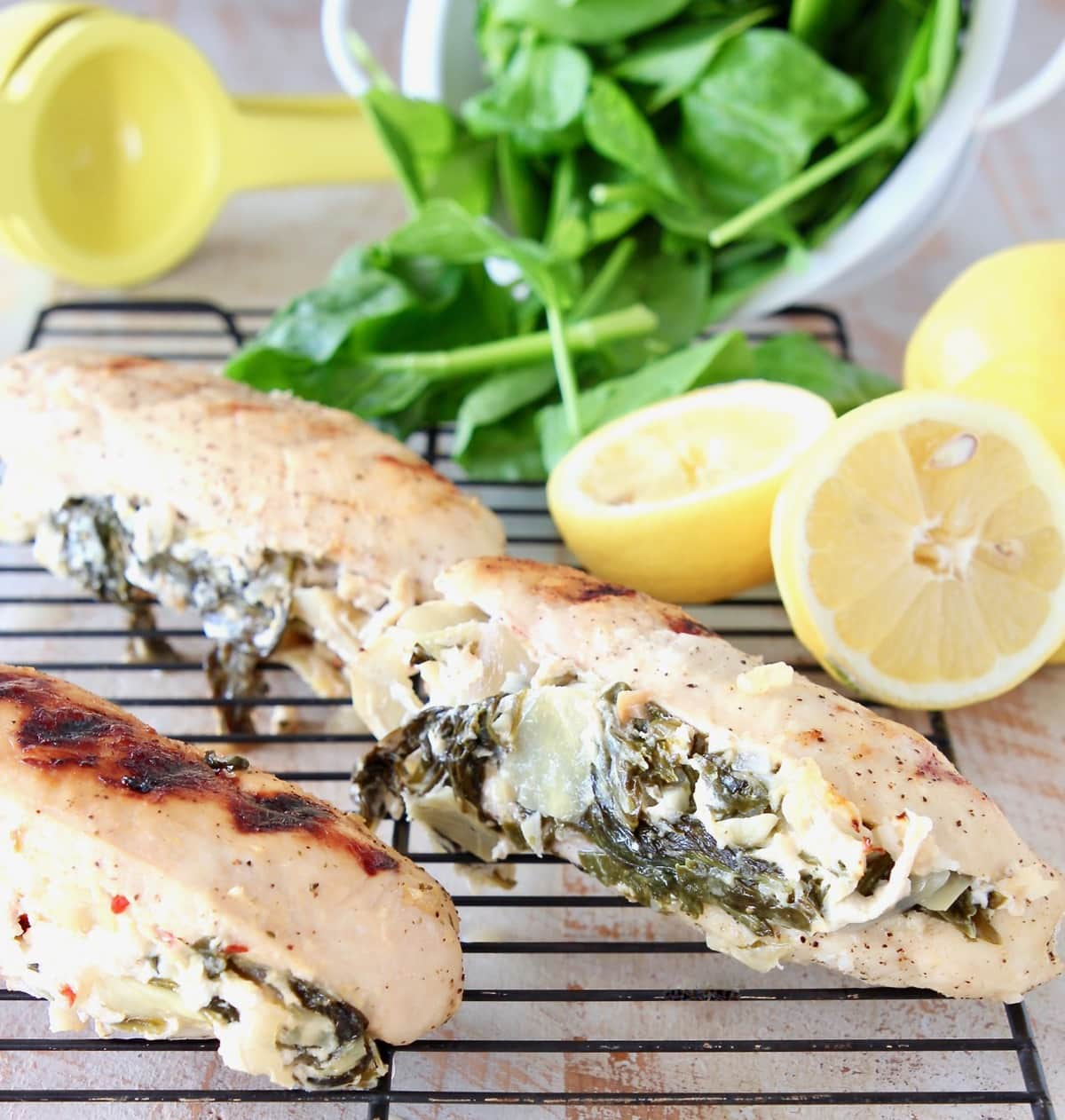 Stuffed Spinach Artichoke Chicken with Lemons and Fresh Spinach