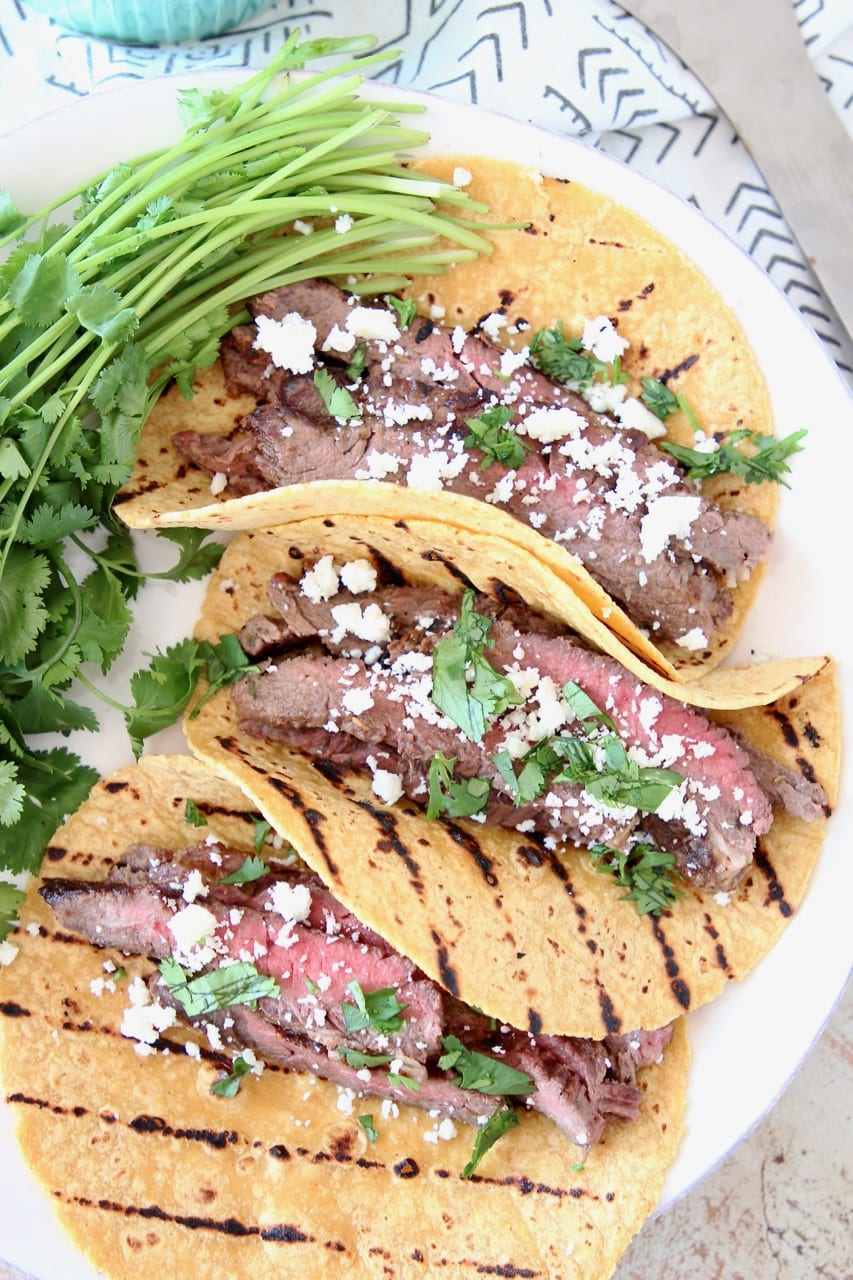Cajun Steak Tacos with Grilled Corn Tortillas, Cotija Cheese and Fresh Cilantro