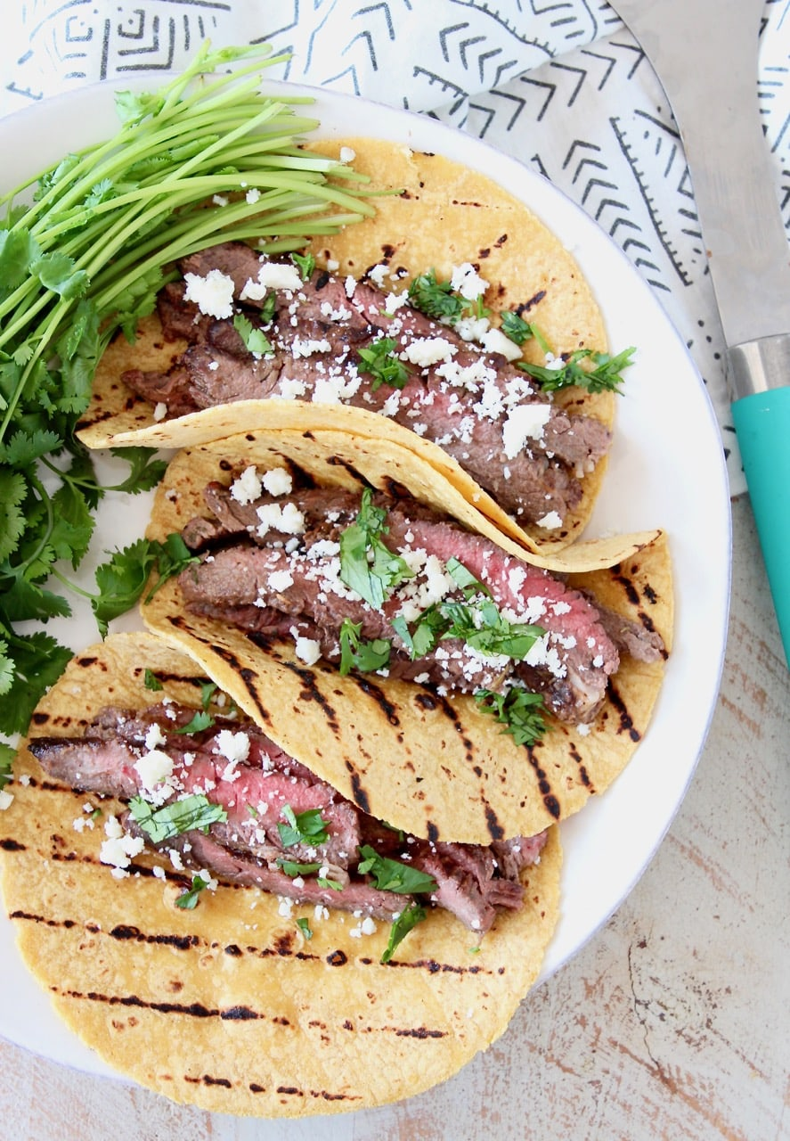 Cajun Steak Tacos in Grilled Corn Tortillas with Fresh Cilantro and Cotija Cheese