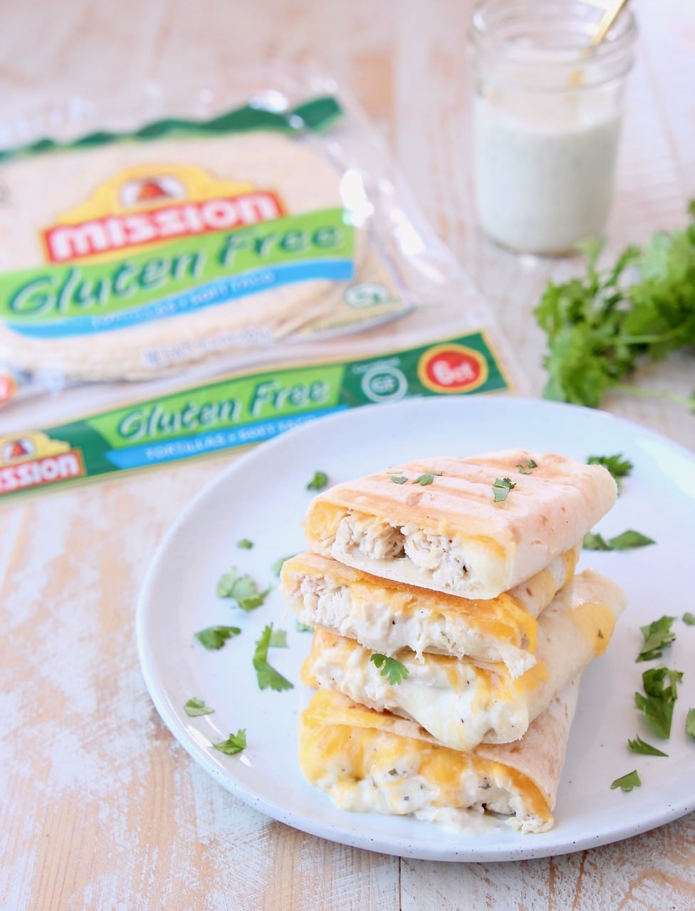 Gluten Free Tortillas in package with Gluten Free Chicken Ranch Wraps grilled and cut in half