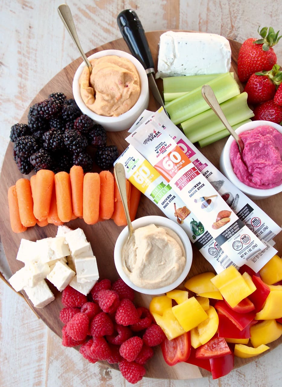 Low Calorie Gluten Free Charcuterie Board with Berries, Celery, Carrots, Bell Peppers, Hummus and Cheese