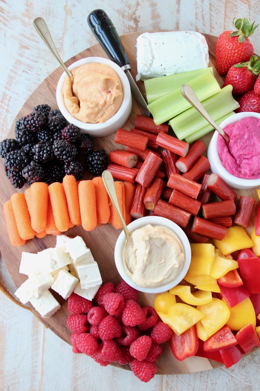 Low Calorie Charcuterie Board with Carrots, Celery, Bell Peppers, Hummus, Berries and Chicken Snack Sticks