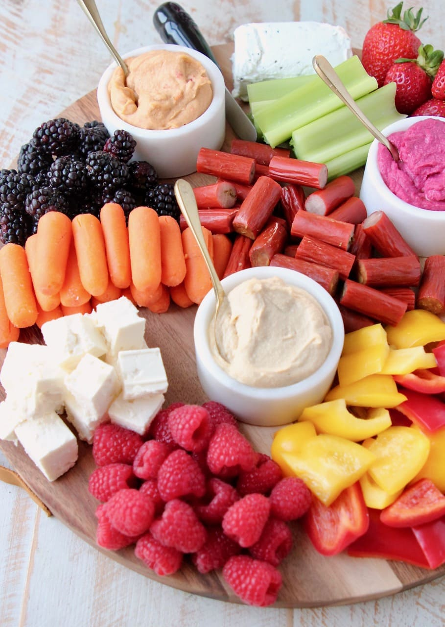 Low Calorie Charcuterie Board with Hummus, Veggies, Fruits, Cheeses and Chicken Snack Sticks