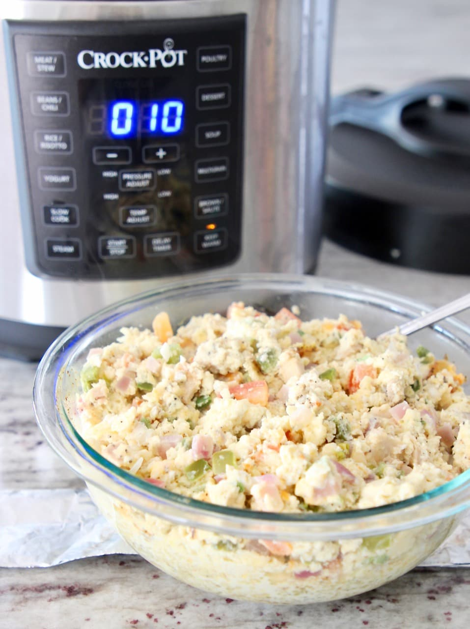 Scrambled eggs for breakfast tacos in bowl with Crock Pot pressure cooker
