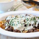 Frito Cheesesteak Pie with ground beef and creamy provolone sauce in casserole dish