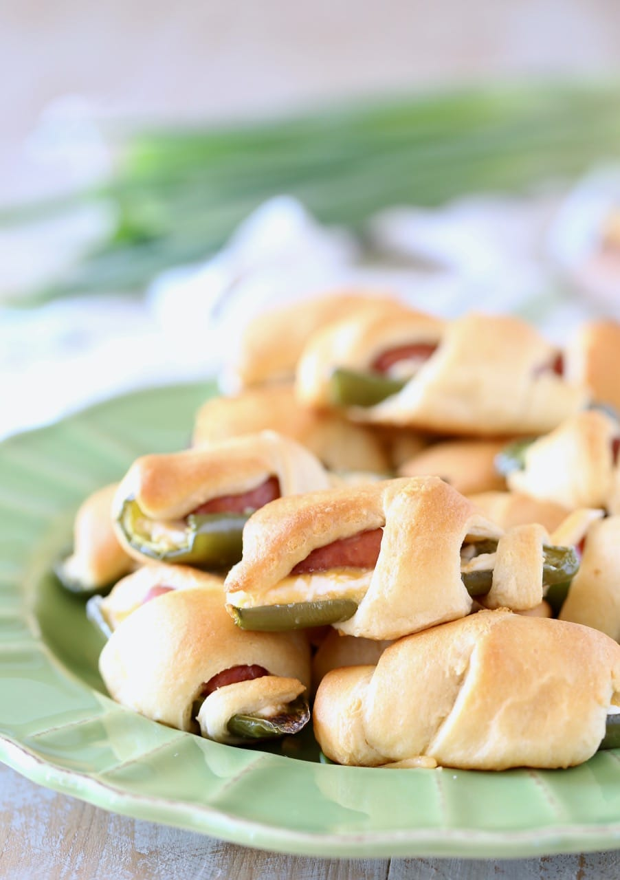 Jalapeno Poppers with Little Smokies Wrapped in Crescent Roll Dough on a plate