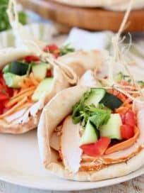 Turkey pita wrap with cucumber, cilantro, carrots and bell peppers