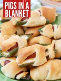 jalapeno popper pigs in a blanket on green plate