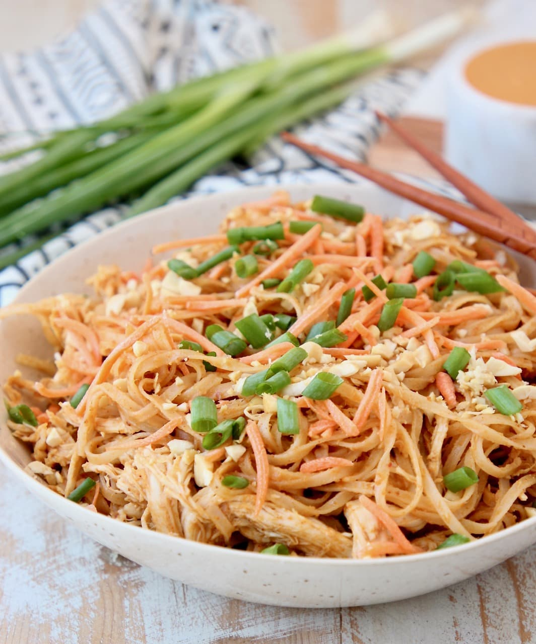 Pressure cooker Thai Peanut Chicken Noodles with shredded carrots, peanuts and scallions