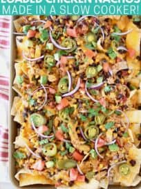 Overhead image of nachos on baking sheet topped with sliced jalapenos and onions