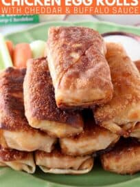 egg rolls stacked up on plate