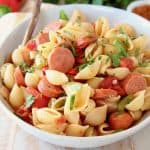 Cajun pasta with sausage in bowl with copper fork