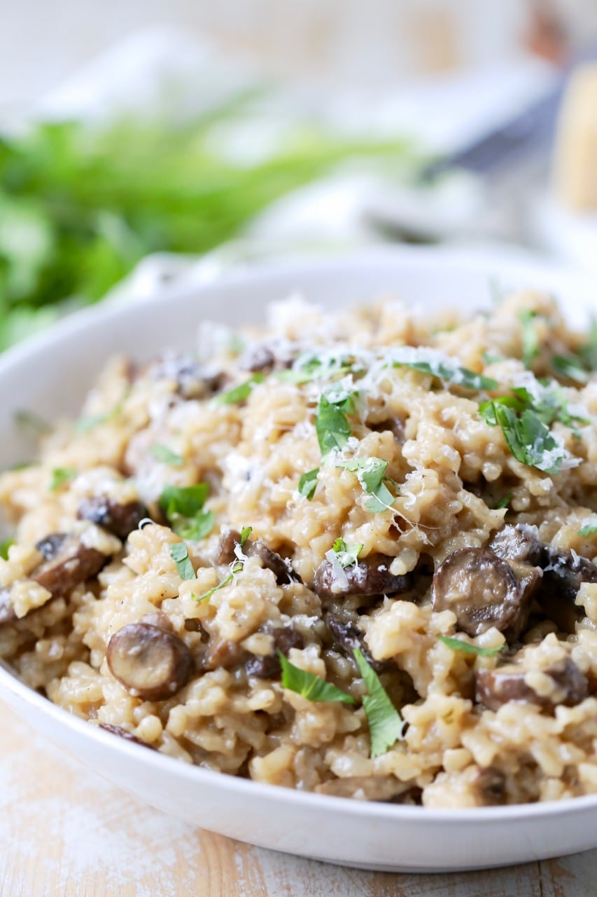 Instant pot risotto with mushrooms and parmesan cheese in bowl with spoon