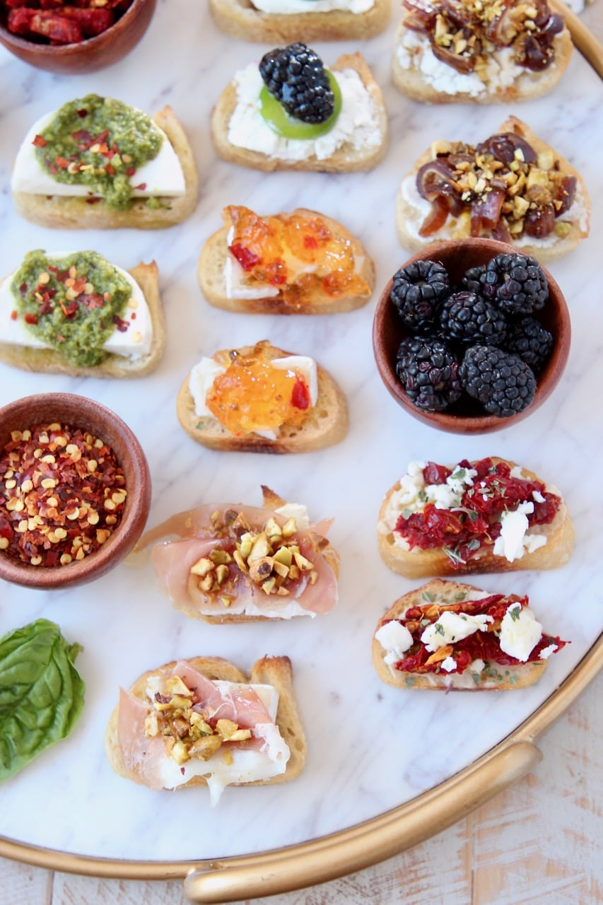 Crostini on marble and gold serving tray