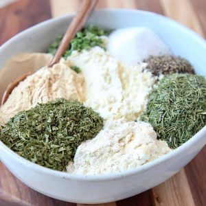 Ranch seasoning ingredients in a bowl with a spoon