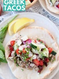 ground turkey meat and tomato salsa in pita bread on plate
