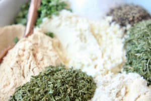Homemade ranch seasoning mix ingredients in bowl with spoon