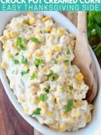 creamed corn in white serving dish with spoon