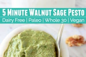 Walnut sage pesto in white marble bowl with small gold spoon